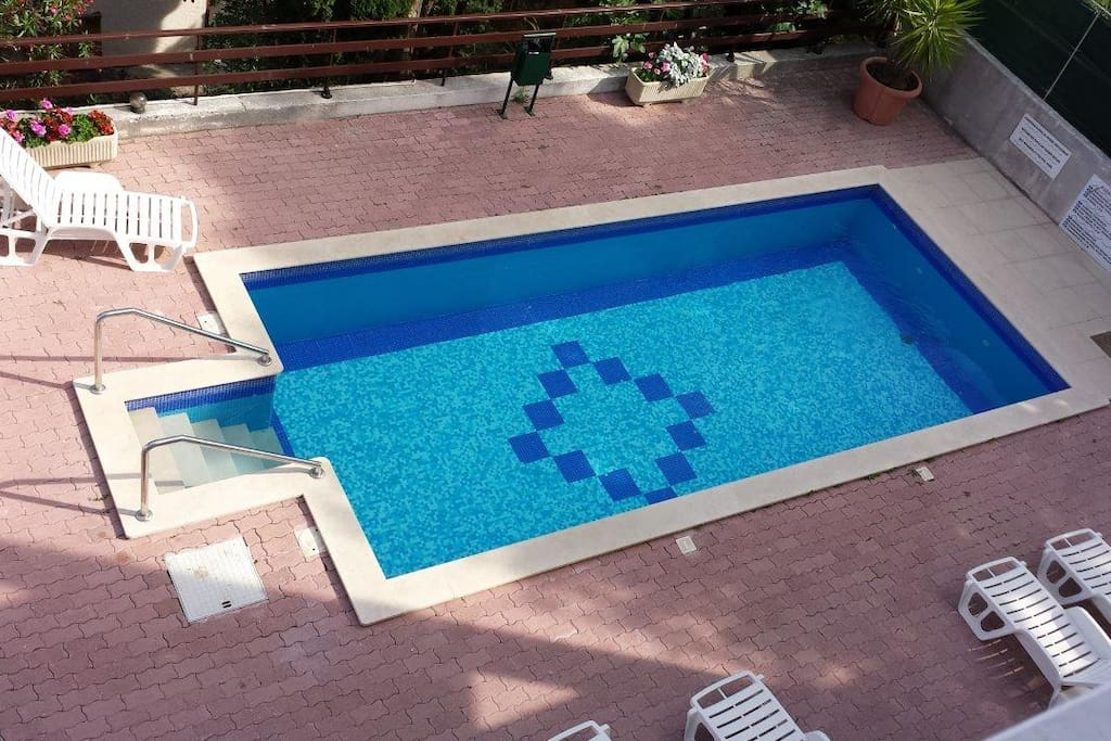 Swimming pool with  plenty of room all around for the kids to play!