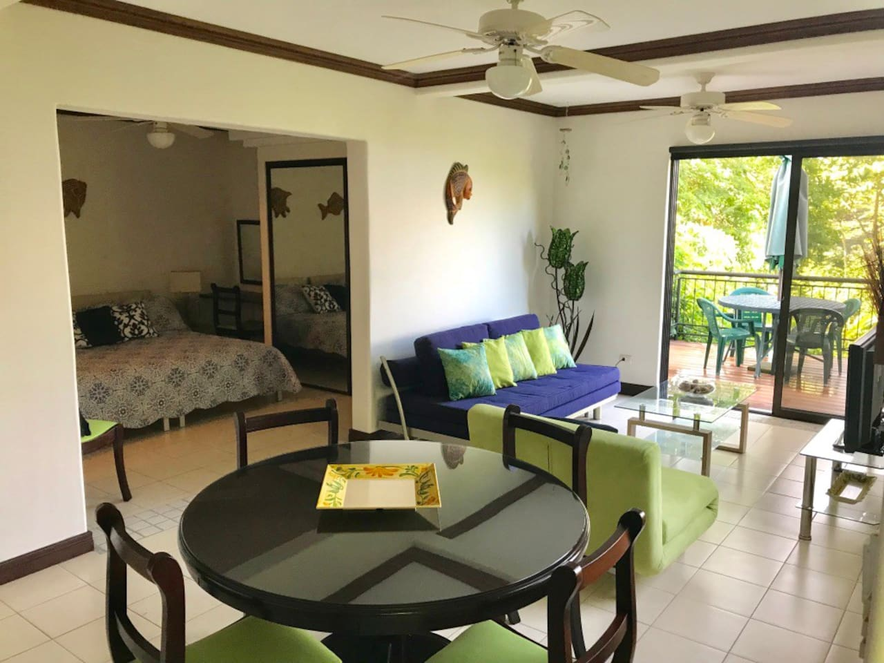 The studio apartment is spacious with a living area and dining area, bedroom, kitchen, bathroom  and private deck.