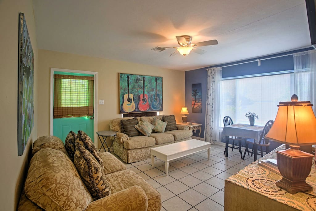 Enjoy tile floors and ceiling fans in every room of this gorgeous house.