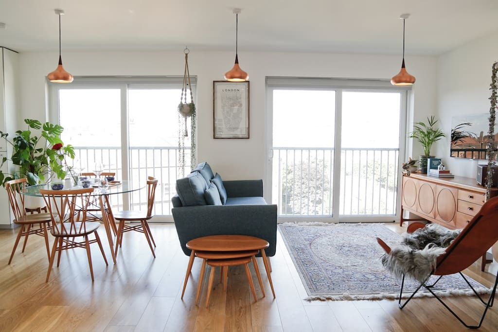 Bright and airy living room with dining area.