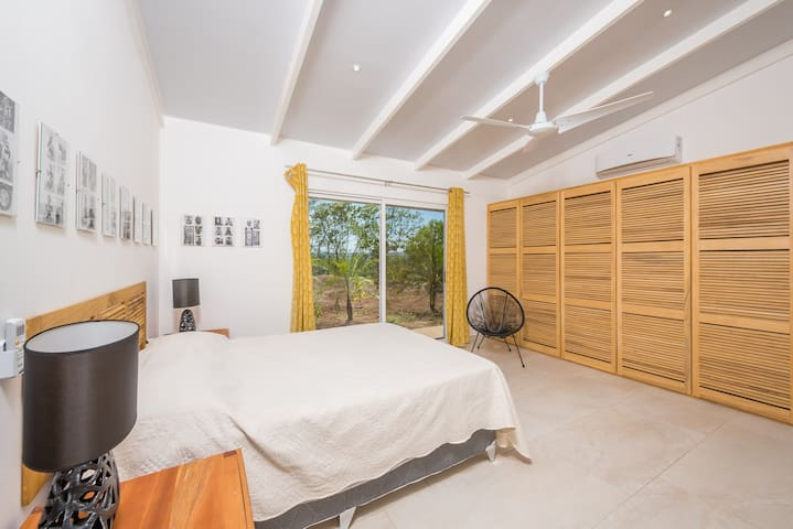 Garden bedroom, also known as the yellow room. Garden views and queen bed.
