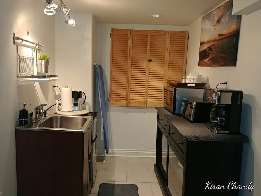 Kitchenette equipped with fridge, Microwave, Oven, Coffee maker, Dishes, Cutlery