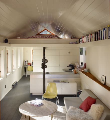 Over view of the light filled studio space. Queen sleeping loft above.