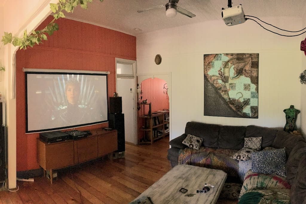 The open and spacious lounge room with projector #2