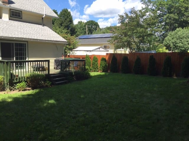 Back yard, fully fenced in, with gates on each side