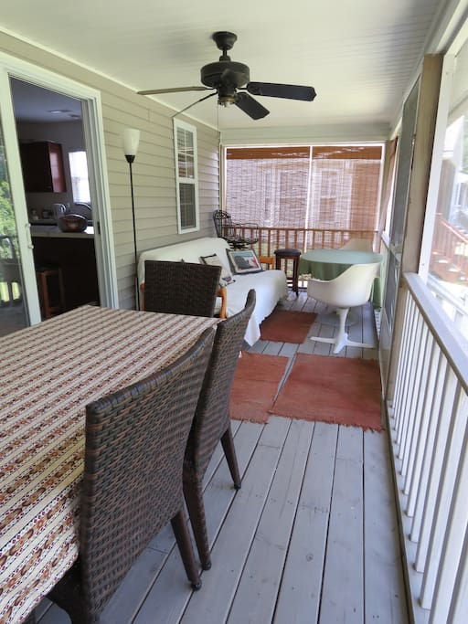 Spacious screened-in porch with fan and lights, nice view overlooking creek.