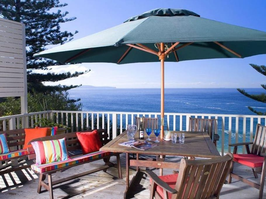 Private deck area with ocean and garden views