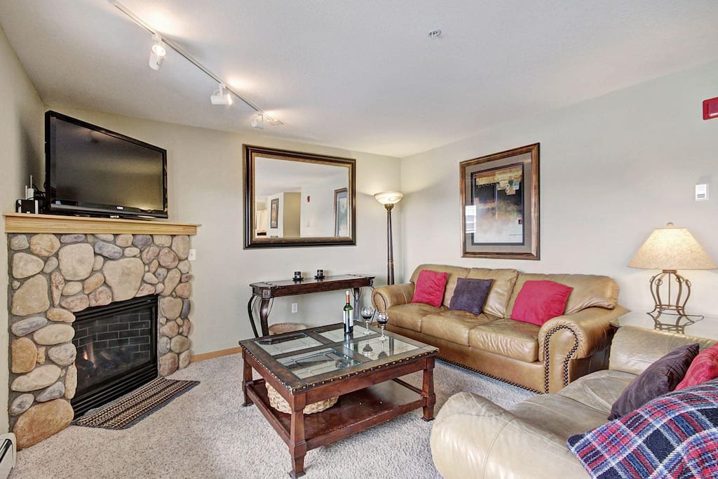 Living area with HD TV & fireplace.