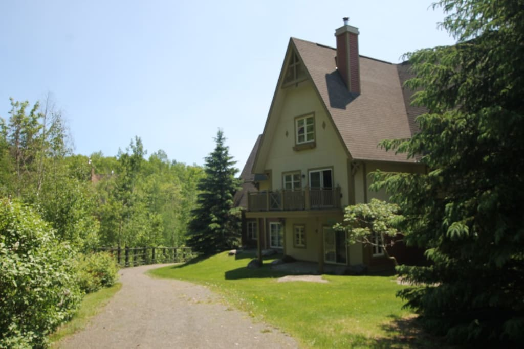 Back of condo: Ski out/path to the pool, pond, and waterfall