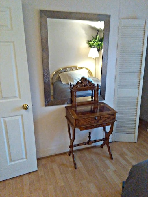 Detail of a room, antique dresser/desk. This also includes an antique rocker. You also have a fridge and microwave.