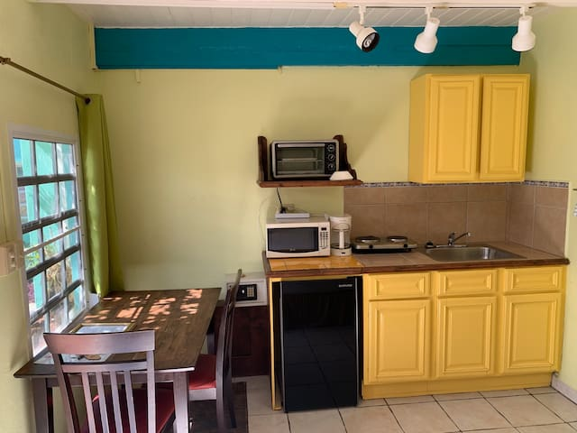 the kitchen is petite, but complete