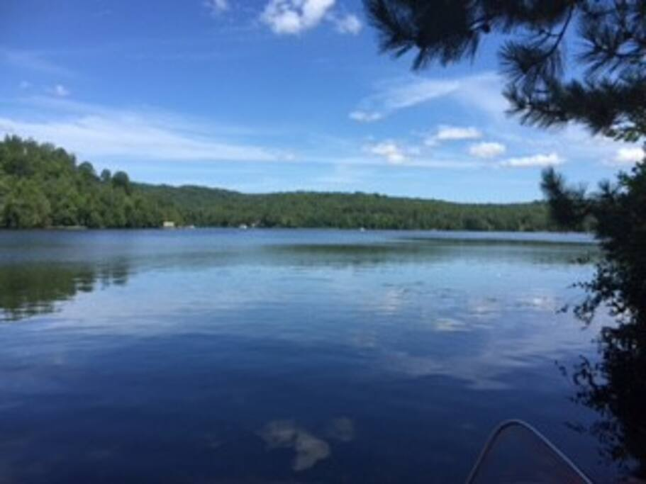 View from the dock- beautiful & clean Lac des Trois Montagnes-7kms long of kayaking or canoeing- with lots to explore The running ed beaches of La Riviere Rouge are only a short way away