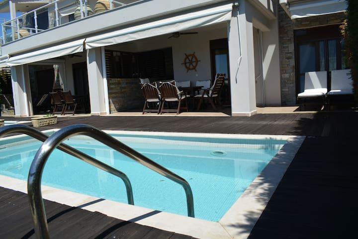 Azapiko beachfront 3 story villa with pool