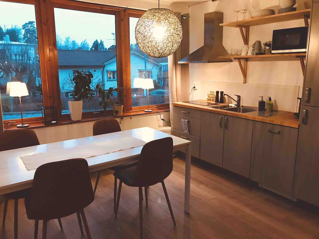 Newly renovated Kitchen. Dinner table. Windows that allow lots of sun.
