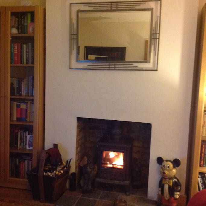 Cosy lounge with log burner.. stripped floors..