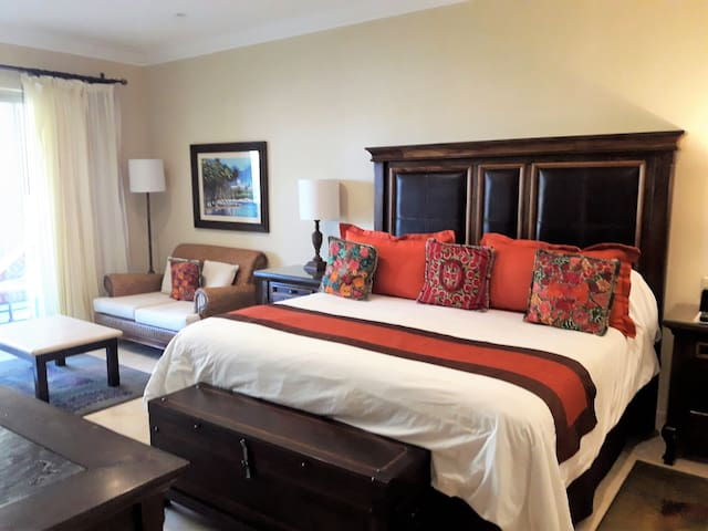 King size bed and sitting area in a spacious master bedroom