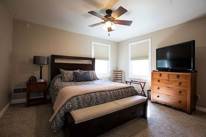 Bedroom 2 features a cozy queen bed, plenty of closet & dresser space, plus a flat-screen TV with Roku stick!