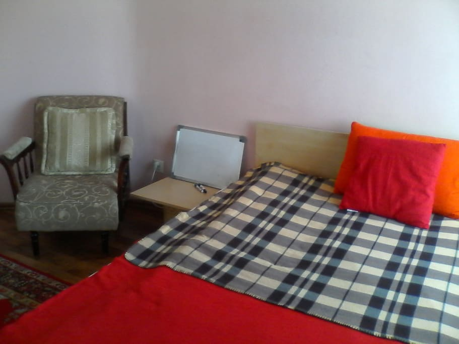 Bedroom - armchair and white board