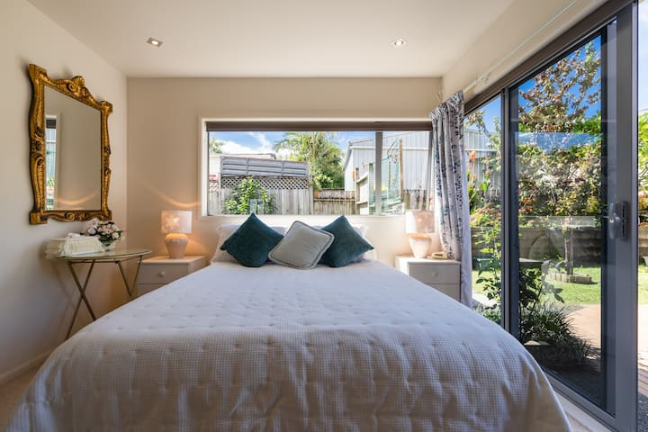Coral Room with Queen size bed.