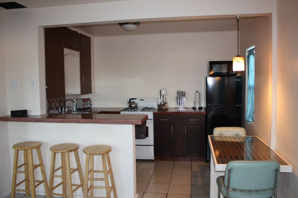 Kitchen with bar counter, concrete countertops