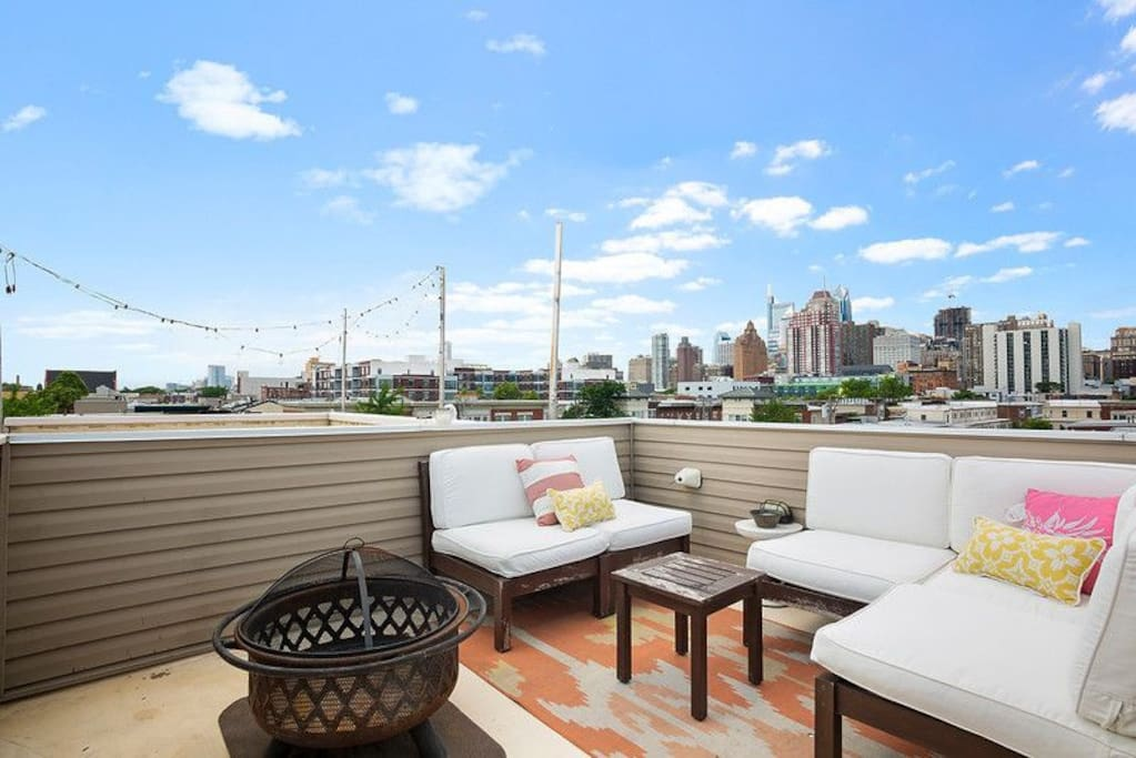 360 degree view of the City with fire pit and couches.