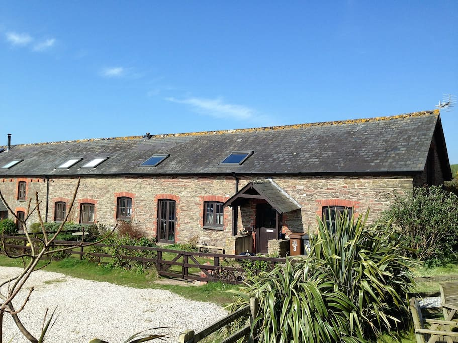 Our spacious family home is one of seven barn conversions, perfectly situated on the south Devon coast for family beach holidays. A little walk to the beach and overlooking the picturesque Avon Estuary, our home is surrounded by glorious coast and countryside just waiting for you to discover.