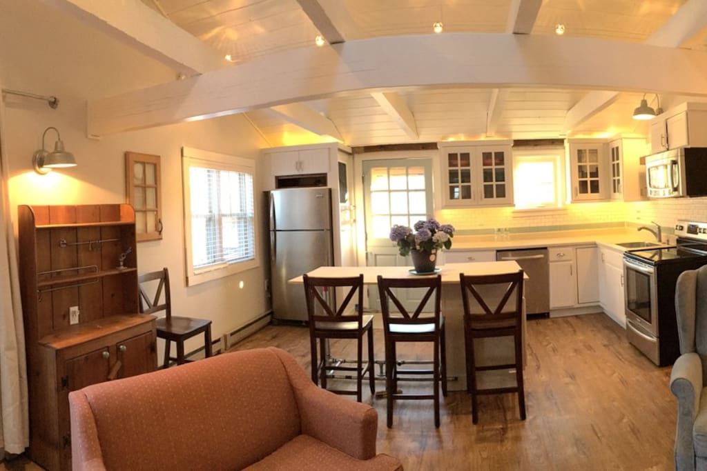Panoramic view of kitchen and living area.