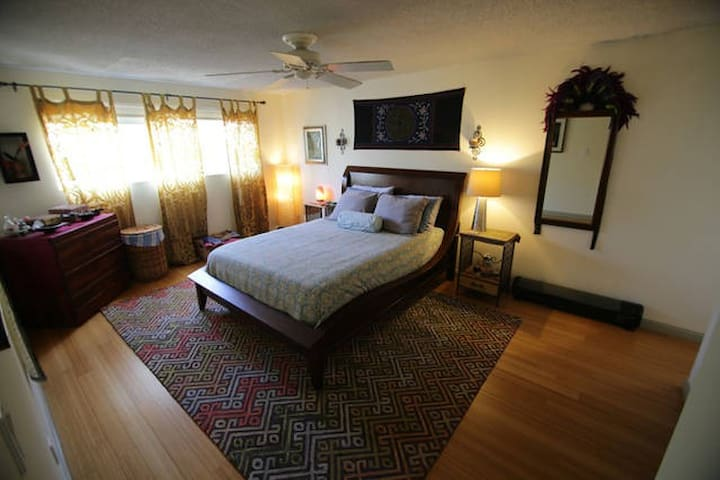 Large master bedroom with queen bed and private ensuite bathroom.