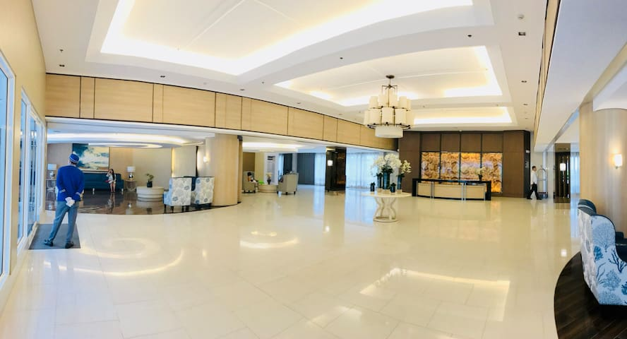Meet you at the Grand lobby of Tower B. TOWER B IS NEAR ALPHA MART 24X7 CONVENIENCE STORE, MASSAGE, ATM, COFFEE SHOP, ICE CREAM SHOP & RESTAURANTS.