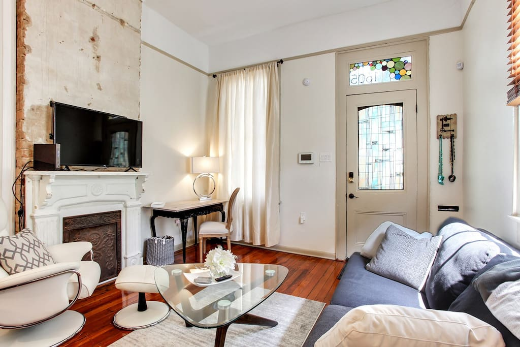 Bright and airy front room with original fireplace. Hardwood floors throughout home.