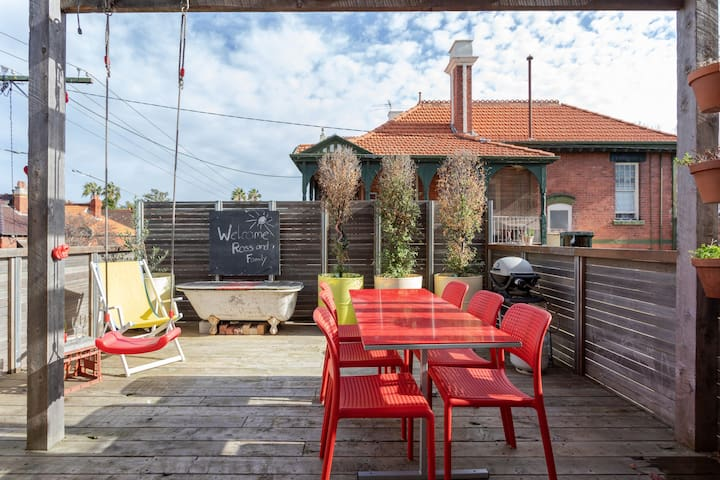 Huge rooftop deck with large dinning table and BBQ