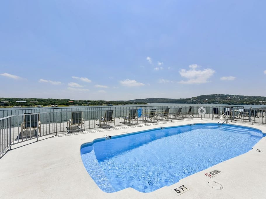 A sparkling swimming pool for your use in the center of this luxury community.