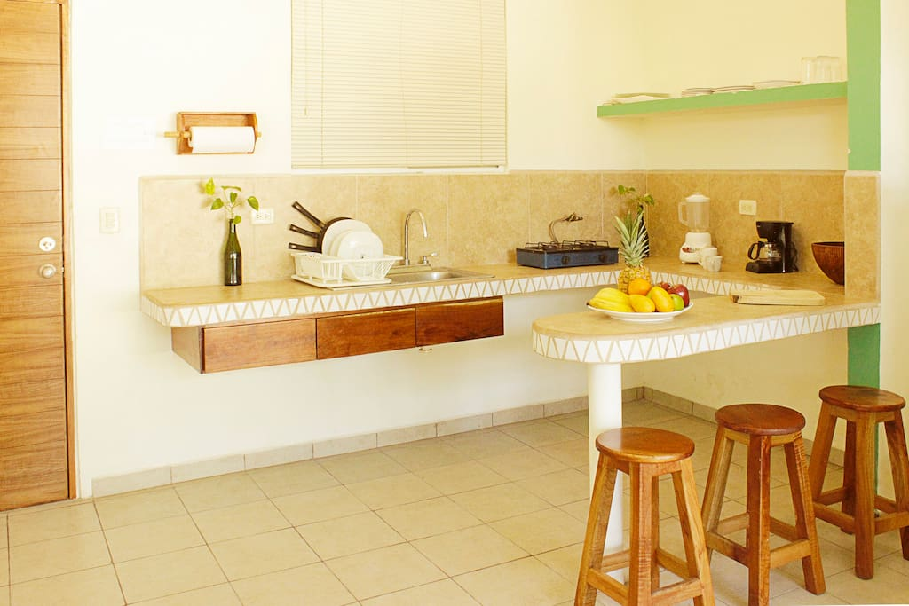Kitchenette with everything you need for basic cooking. Includes full fridge and drinking water
