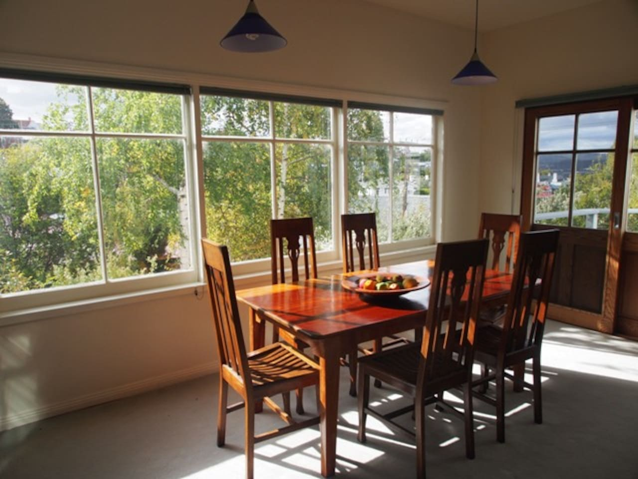 Our Airbnb has a large sunny lounge and dining room with a view over the garden and city
