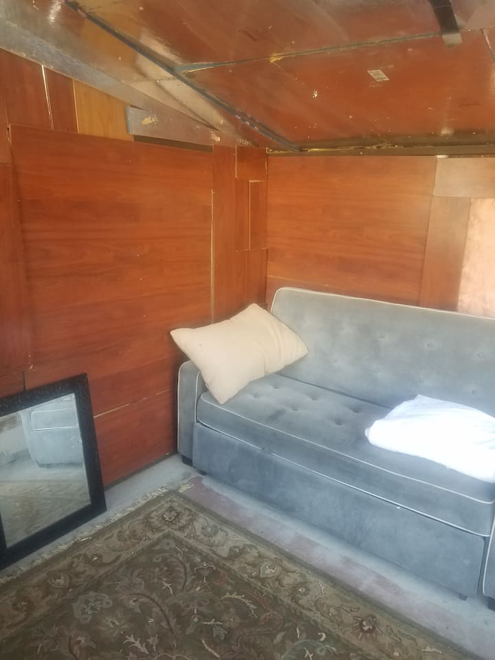 Shack,  camping toilet,   mirror on ceiling,  ac.
