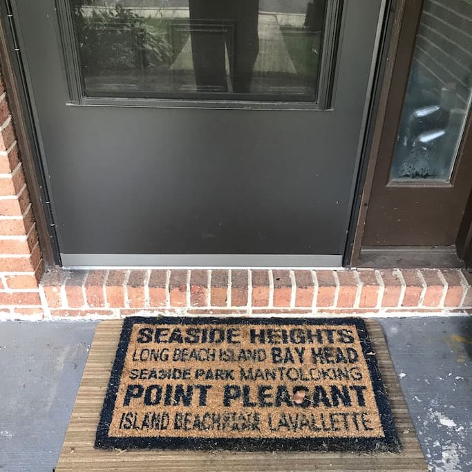 Front porch, floor mat indicating all beaches close by