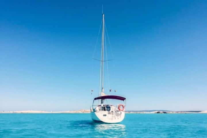 Sailboat with moorage in Ibiza town