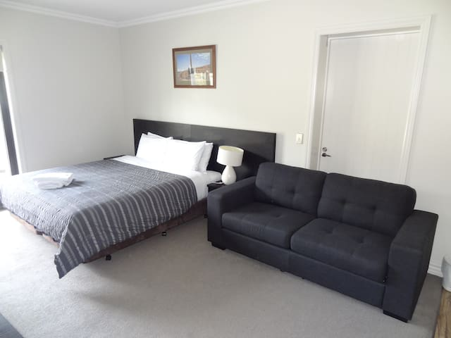 Unit with sofa bed not made up.
