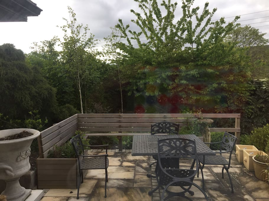 Outdoor dining area overlooking garden