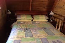 Cedar loft cabin bedroom on mezzanine floor