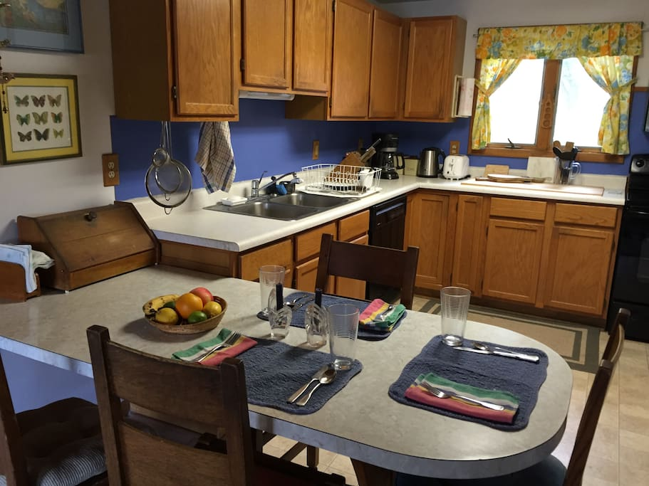 Kitchen has up-to-date appliances and room for 5-6 at the counter.