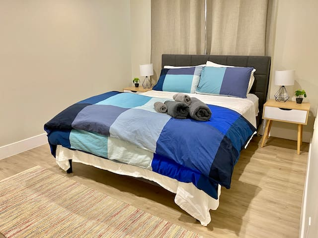 Modern and clean design Queen bedroom with cozy white sheet set and modern duvet for a very comfortable good night sleep. Bedroom is equipped with Blackout curtains with another layer of sheer curtains to utilize the daylight during the daytime