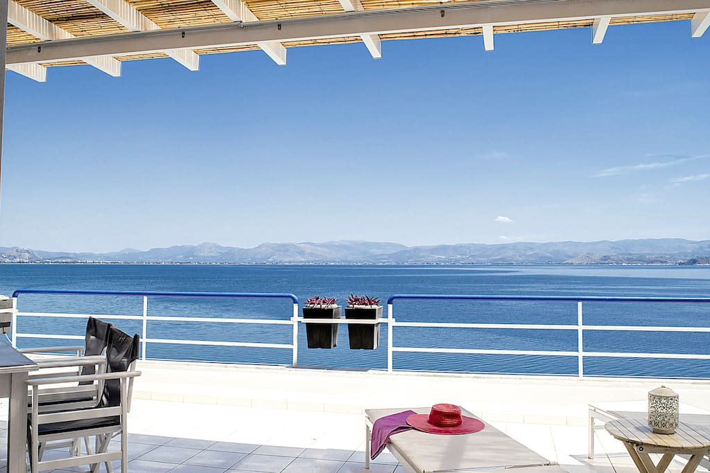 Sun beds in Balcony -Waterfront Loft Apartment in Kiveri village close to Nafplion