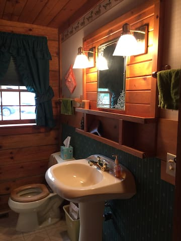 Full Bathroom with tub/shower combo.
