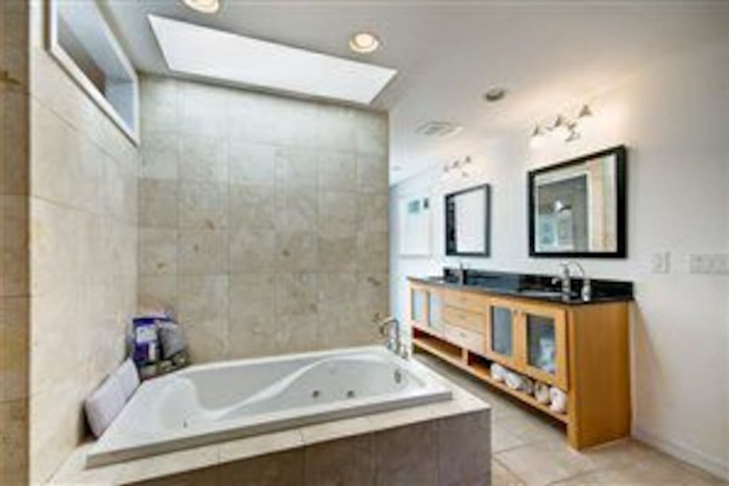 Master Bathroom, shower, walk in closet and jetted tub