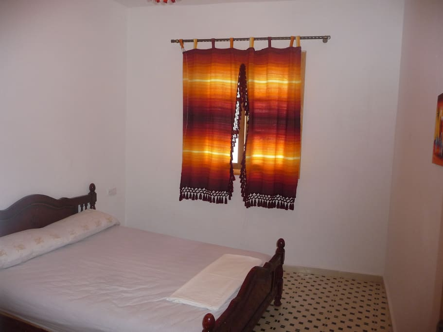 bedroom with a large bed for 2 per