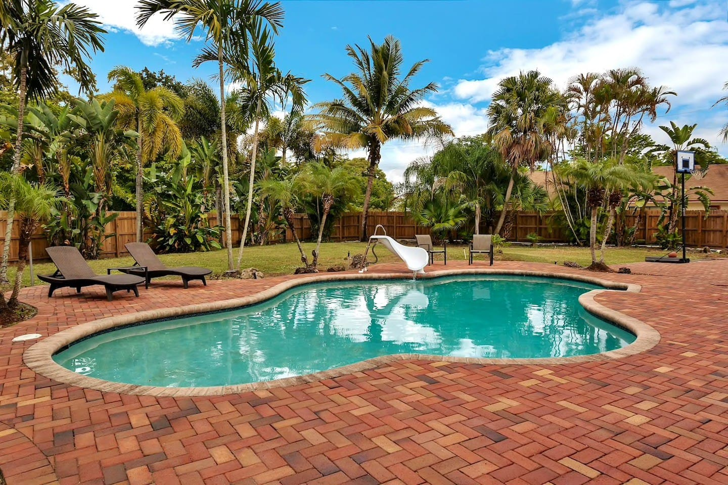 Relax in a private saltwater pool oasis. Yes there's a BBQ grill included. All that's missing is you and your crew :)
