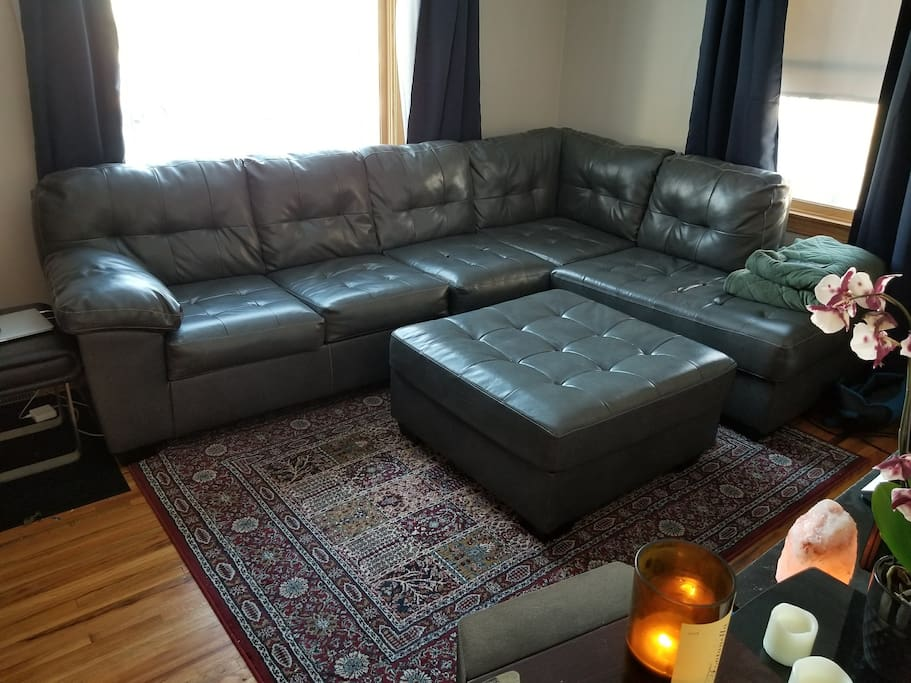 Large living room couch with room for 1-2 people to sleep.