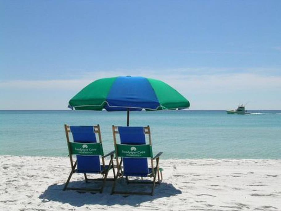 Private beach with chair and umbrella rentals