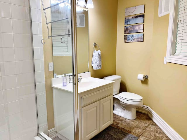 Your full private bathroom has plenty of fresh towels and linens.